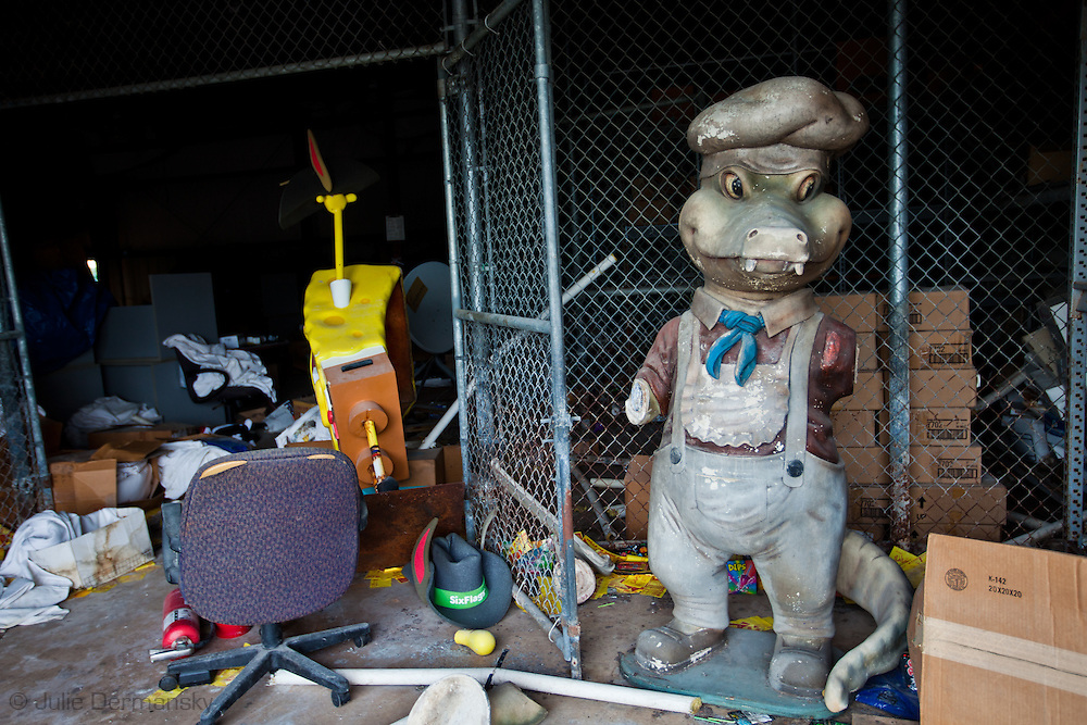Mardi Gras dol on the floor in a stock room in an abandoned build at Six Flags in New Orleans. Six Flags New Orleans amusement park in Eastern New Orleans, Louisiana, closed since Hurricane Katrina  in 2005 remains in a sate of ruin. The remains of Six Flags amusement park are on low lying land owned by the city of New Orleans and have not be redeveloped since Katrina.