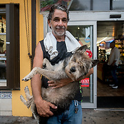 SEPTEMBER 9, 2017--MIAMI--FLORIDA<br /> Little Havana resident Jose Garcia holds his dog Chapo outside one of a few neighborhood markets still open Saturday morning.<br /> (Photo by Angel Valentin)