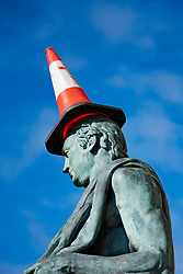 Traffic cone on head of David Hume statue on Royal Mile in Edinburgh, Scotland, UK