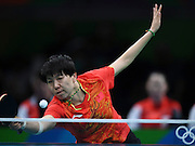 RIO DE JANEIRO, BRAZIL - AUGUST 15: <br /> <br /> Li Xiaoxia of China competes against Feng Tianwei of Singapore during the Table Tennis Women\'s Team Round Semi Final between China and Singapore during Day 10 of the Rio 2016 Olympic Games at Riocentro - Pavilion 3 on August 15, 2016 in Rio de Janeiro, Brazil. <br /> ©Exclusivepix Media