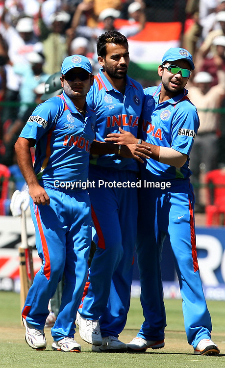 Indian bowler Zaheer Khan celebrates with team Ireland batsman Paul Stirling wicket during the ICC Cricket World Cup - 22nd Match, Group B, India vs Ireland Played at M Chinnaswamy Stadium, Bangalore, 6 March 2011 - day/night (50-over match)