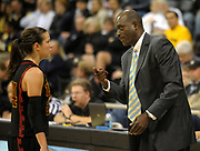 Dec 3, 2009; Long Beach, CA, USA; Southern California Trojans coach Michael Cooper (right) talks with guard Ashley Corral (24) during the game against the Long Beach State 49ers at the Walter Pyramid. USC defeated Long Beach State 83-77.