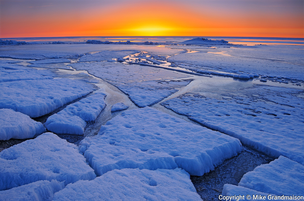 Ice on shore of Lake Winnipeg in spring at sunrise<br /> Winnipeg Beach<br /> Manitoba<br /> Canada