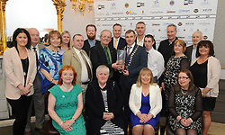 Martin Keane with his guests accecpting his Westport Lions club Clew Bay People of the Year Award from Darren Cawley.<br /> Pic Conor McKeown