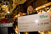 PATSY KENSIT RECEIVES A CHEQUE FOR £10,000 ON BEHALF OF MACMILLAN CANCER RESEARCH FROM LAURENCE DAVIS. , Patsy Kensit turns on Burlington Arcade Christmas Lights, Burlington Arcade, London, W1. 26 November 2008 *** Local Caption *** -DO NOT ARCHIVE -Copyright Photograph by Dafydd Jones. 248 Clapham Rd. London SW9 0PZ. Tel 0207 820 0771. www.dafjones.com