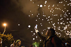 October 20, 2016 - Chicago, United States - 600 balloons are released, each one representing a life lost to gun violence thus far in 2016 during a Laquan Day rally in Chicago on October 20, 2016. Over 200 people gathered outside Chicago Police Headquarters to commemorate the life of 17-year-old police shooting victim Laquan McDonald on the two year anniversary of his death. (Credit Image: © Max Herman/NurPhoto via ZUMA Press)