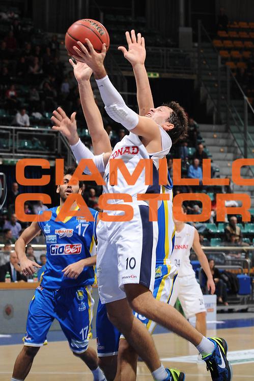 DESCRIZIONE : Bologna Lega Basket A2 2011-12 Conad Biancoblu Basket Bologna Assi Basket Ostuni<br /> GIOCATORE : Andrea Pecile<br /> CATEGORIA : tiro<br /> SQUADRA : Conad Biancoblu Basket Bologna <br /> EVENTO : Campionato Lega A2 2011-2012<br /> GARA : Conad Biancoblu Basket Bologna Assi Basket Ostuni<br /> DATA : 06/11/2011<br /> SPORT : Pallacanestro<br /> AUTORE : Agenzia Ciamillo-Castoria/M.Marchi<br /> Galleria : Lega Basket A2 2011-2012 <br /> Fotonotizia : Bologna Lega Basket A2 2011-12 Conad Biancoblu Basket Bologna Assi Basket Ostuni<br /> Predefinita :