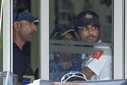 August 6, 2017 - Colombo, Sri Lanka - Sri Lankan captain Dinesh Chandimal (R)  and Sri Lankan Cricket's interim coach Nic Pothas(L) look out from the window of Sri Lankan cricket team's dressing room after India defeated Sri Lanka by an innings and 53 runs during the 4th Day's play in the 2nd Test match between Sri Lanka and India at the SSC international cricket stadium at the capital city of Colombo, Sri Lanka on Sunday 6 August 2017. (Credit Image: © Tharaka Basnayaka/NurPhoto via ZUMA Press)