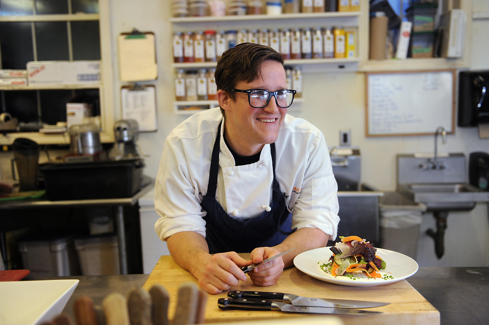 Zebra Bistro Chef Brendan Pelley presents his salad of baby greens with goat cheese emulsion, one of the dishes he will feature during March's Dine Out Boston event, Feb. 18, 2014.<br /> Wicked Local staff photo/Kate Flock