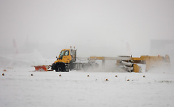 ©London News Picures. Gritting teams at Gatwick airport runway after heavy snow forced all flights grounded. The airport is closed and all flights are canceled untill Thursday morining  due to havy snow on December 1st. Photo credit should read Fuat Akyuz/London News Pictures