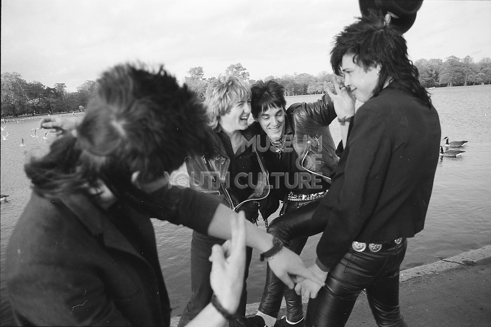 Micky and the Fits punk band messing about by the Serpentine, London, UK. 1980s.