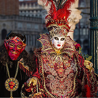 VENICE, ITALY - FEBRUARY 25:  A couple dressed in Carnival Costumes poses inSaint Mark's Square on February 25, 2014 in Venice, Italy. The 2014 Carnival of Venice will run from February 15 to March 4 and includes a program of gala dinners, parades, dances, masked balls and music events.  (Photo by Marco Secchi/Getty Images)
