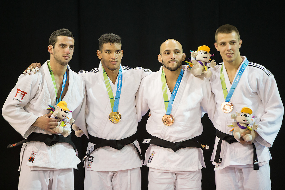 Gold medalist Magdeil Estrada (2nd Left) of Cuba is joined by Alejandro Clara (L) of Argentina, and bronze medalists Arthur Margelidon (R) of Canada and Augusto Miranda of Puerto Rico during the medal ceremony for the men's judo 73kg class at the 2015 Pan American Games in Toronto, Canada, July 12,  2015   AFP PHOTO/GEOFF ROBINS