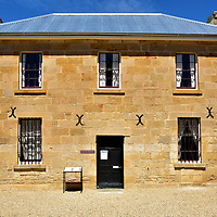 """Richmond Gaol in Richmond, Australia<br /> Starting in the 1820s, Richmond imported British convicts as slave labor for building their village. One of the criminals' biggest projects was constructing their own jail from 1825 until 1840. The stories you will read while walking around the gaol are ghoulish. You will learn how prisoners huddled together in cramped cells called the Sleeping Rooms while wearing leg irons. They were the lucky ones. Others suffered solitary confinement, were subjected to repeated lashings in the Flogging Yard and executed by Solomon Blay, known as the """"The Hangman."""" This Gaoler's Residence, created by John Lee Archer in the 1830s, is at one end of the Airing Yard where prisoners were allowed to exercise twice a day."""