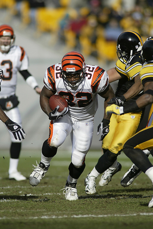 Running back Rudi Johnson of the Cincinnati Bengals carries the ball during their 24-20 victory over the Pittsburgh Steelers on 11/30/2003. ©JC Ridley/NFL Photos.