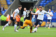 Bradford City defender James Meredith (3) and James Henry of Bolton Wanderers (24) attempt to win the ball during the EFL Sky Bet League 1 match between Bolton Wanderers and Bradford City at the Macron Stadium, Bolton, England on 24 September 2016. Photo by Simon Brady.