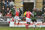 Doncaster Rovers player Andy Boyle (24) heads ball clear of Rotherham United player David Ball (10) during the EFL Sky Bet League 1 match between Rotherham United and Doncaster Rovers at the AESSEAL New York Stadium, Rotherham, England on 24 February 2018. Picture by Ian Lyall.