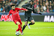 Liverpool forward Mohamed Salah (11) tussles with Red Bull Salzburg defender Jérôme Onguéné (6) during the Champions League match between FC Red Bull Salzburg and Liverpool at the Red Bull Arena, Salzburg, Austria on 10 December 2019.