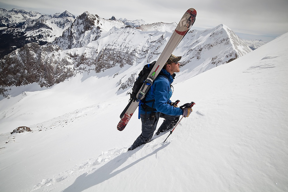 Backcountry skier Sterling Roop climbs to the summit of Hayden Peak, San Juan Mountains, Colorado.