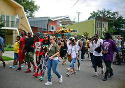 29 August 2014. Lower 9th Ward, New Orleans, Louisiana. <br /> Survivors of the storm. A second line parade with residents, activists  and survivors winds its way through the Lower 9th Ward  in memory of those who perished in the storm 9 years ago.<br /> Photo; Charlie Varley/varleypix.com