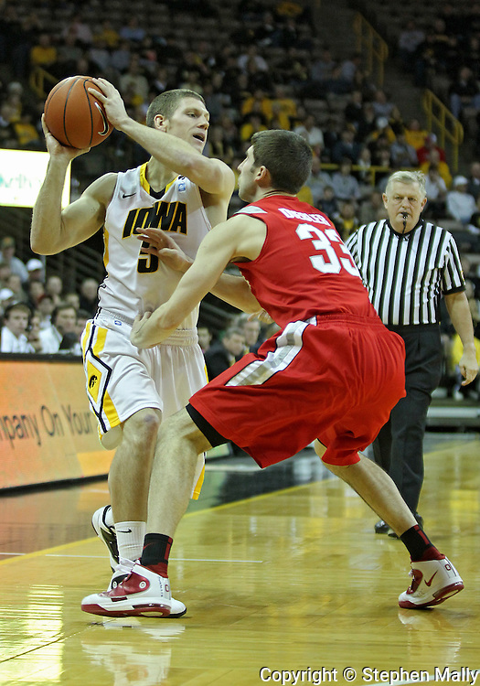 January 04 2010: Iowa Hawkeyes guard Matt Gatens (5) tries to keep the ball away from Ohio State Buckeyes guard Jon Diebler (33) during the first half of an NCAA college basketball game at Carver-Hawkeye Arena in Iowa City, Iowa on January 04, 2010. Ohio State defeated Iowa 73-68.