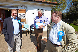 © Licensed to London News Pictures.  02/05/2013. AYLESBURY, UK. Clive Harriss (pictured left), Conservative party candidate for the Stone and Waddesdon on Buckinghamshire County council visits his local polling station during voting for the local council elections. Also in this picture: Lawrence Renshell (centre) and Barry Macleod-Cullinane (right). Photo credit: Cliff Hide/LNP
