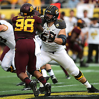 ORLANDO, FL - JANUARY 01:  Mitch Morse #65 of the Missouri Tigers blocks during the Buffalo Wild Wings Citrus Bowl between the Minnesota Golden Gophers and the Missouri Tigers at the Florida Citrus Bowl on January 1, 2015 in Orlando, Florida. (Photo by Alex Menendez/Getty Images) *** Local Caption *** Mitch Morse