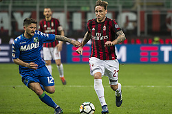 April 8, 2018 - Milan, Milan, Italy - 8th April 2018, San Siro, Milan, Italy; Serie A football, AC Milan versus US Sassuolo; Lucas Biglia of AC Milan ompetes for the ball with Stefano Sensi of US Sassuolo (Credit Image: © Gaetano Piazzolla/Pacific Press via ZUMA Wire)