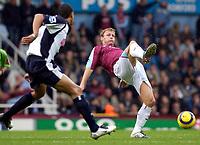 Photo: Daniel Hambury.<br />West Ham Utd v West Bromwich Albion. The Barclays Premiership. 05/11/2005.<br />West Ham's Teddy Sheringham (R) stretches for the ball.