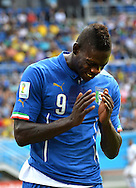 Mario Balotelli of Italy reacts during the 2014 FIFA World Cup match at Arena das Dunas, Natal<br /> Picture by Stefano Gnech/Focus Images Ltd +39 333 1641678<br /> 24/06/2014
