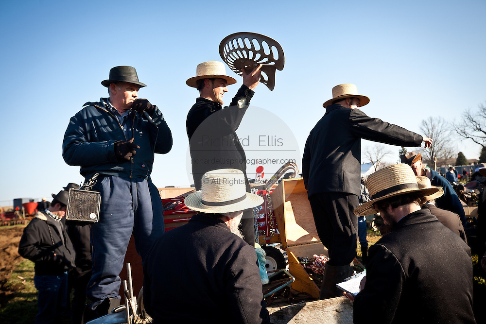 Amish auctioneers during the Annual Mud Sale to support the Fire Department  in Gordonville, PA.