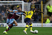 Robert Snodgrass (11) of West Ham United tackles Shandon Baptiste (16) of Oxford United during the EFL Cup match between Oxford United and West Ham United at the Kassam Stadium, Oxford, England on 25 September 2019.