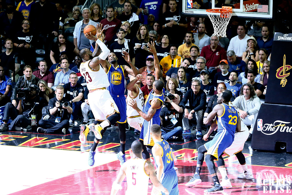 09 June 2017: Cleveland Cavaliers forward LeBron James (23) takes a jump shot over Golden State Warriors forward Andre Iguodala (9) and Golden State Warriors forward Kevin Durant (35) during the Cleveland Cavaliers 137-11 victory over the Golden State Warriors, in game 4 of the 2017 NBA Finals, at  the Quicken Loans Arena, Cleveland, Ohio, USA.