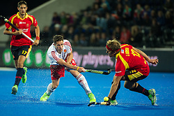 England's Mark Gleghorne pass eludes Jordi Carrera of Spain. England v Spain - Unibet EuroHockey Championships, Lee Valley Hockey & Tennis Centre, London, UK on 25 August 2015. Photo: Simon Parker
