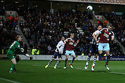 Sam Vokes of Burnley gets ahead of Bailey Wright of Preston to head just over  during the Sky Bet Championship match between Preston North End and Burnley at Deepdale, Preston, England on 22 April 2016. Photo by Simon Brady.