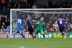 AFC Wimbledon's Jack Midson goes around Bristol Rovers' goalkeeper, Steve Mildenhall but later misses a shot - Photo mandatory by-line: Dougie Allward/JMP - Mobile: 07966 386802 05/04/2014 - SPORT - FOOTBALL - Kingston upon Thames - Kingsmeadow - AFC Wimbledon v Bristol Rovers - Sky Bet League Two