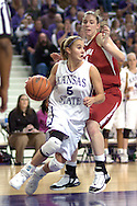 Kansas State guard Shalee Lehning (5) drives the baseline past Oklahoma's Leah Rush, during the second half at Bramlage Coliseum in Manhattan, Kansas, February 21, 2006.  The 9th ranked Sooners defeated K-State 78-64.