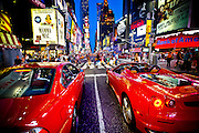 Red cars stopping at a red light on 7th avenue in Times Square, Manhattan, New York, 2010.
