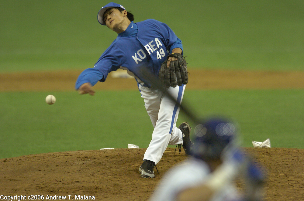 Team Korea Byung-Hyun Kim delivers a pitch against Team Chinese Taipei in the opening game of the World Baseball Classic at Tokyo Dome, Tokyo, Japan.