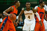 WACO, TX - JANUARY 3: Gary Franklin #4 of the Baylor Bears defends against the Savannah State Tigers on January 3, 2014 at the Ferrell Center in Waco, Texas.  (Photo by Cooper Neill) *** Local Caption *** Gary Franklin