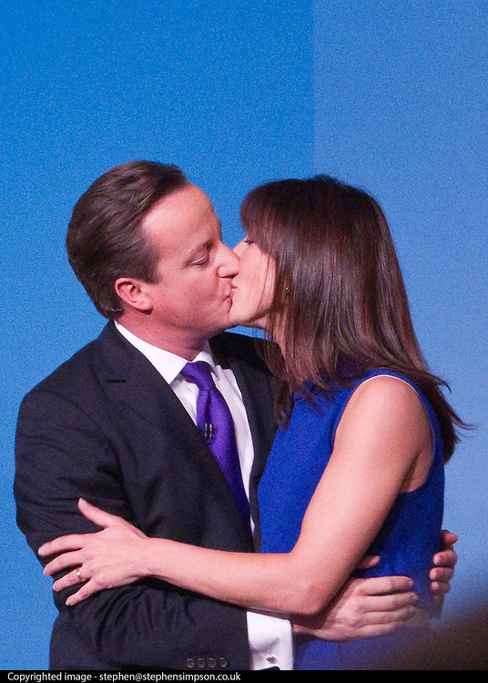 © Licensed to London News Pictures. 10/10/2012. Birmingham , UK . The British Prime Minister , David Cameron , kisses his wife Samantha at the end of his closing speech to the  conference . Day 4 of the Conservative Party Conference at the International Convention Centre in Birmingham . Photo credit : Joel Goodman/LNP