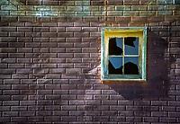 Broken window and brick wall detail; Cripple Creek, Colorado