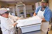 July 26, 2008 -- SNOWFLAKE, AZ: KATHRYN HEININGER and her husband, DAVID HEININGER, make feta cheese in their kitchen at the Black Mesa Ranch, a 280 acre spread in the high desert near Snowflake, AZ. The ranch owners, David and Kathryn Heininger, run a herd of about 40 Nubian dairy goats and hand make artisan cheese from the goat's milk. It's a second gear for them, they retired from Tucson, AZ, where they bought and renovated  historic homes. The moved to the ranch in 2001 and started making and selling cheese shortly after the move. Their cheese is used in expensive restaurants in Phoenix and sold at natural food stores in Arizona.  PHOTO BY JACK KURTZ