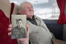 © Licensed to London News Pictures. 29/05/2014. Dennis Davison, 93 holds a photograph of himself as a young solider aged 17.  Dennis along with five other veterans are returning to Normandy as part of the Peace and Unity project.  The organisation, which was set up by Mr Davison was created to work for peace through their combined experiences of war.  In this 70th year since the landings the veterans have travelled from the West Midlands to pay their respects and remember the events of 1944.    <br /> <br /> Dennis, a former member of the Northamptonshire Regiment landed on Sword beach during the D Day landings on the 6 Jun 44.  This is the third time he has been back to Normandy since the landings.  Photo credit : Alison Baskerville/LNP