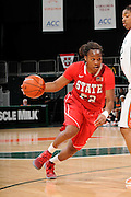 January 5, 2012: Bonae Holston #22 of North Carolina State in action during the NCAA basketball game between the Miami Hurricanes and the North Carolina State Wolfpack at the BankUnited Center in Coral Gables, FL. The Hurricanes defeated the Wolfpack 78-68.