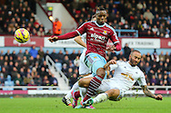 Diafra Sakho of West Ham United is tackled by Ashley Richards of Swansea City during the Barclays Premier League match at the Boleyn Ground, London<br /> Picture by Richard Calver/Focus Images Ltd +447792 981244<br /> 07/12/2014