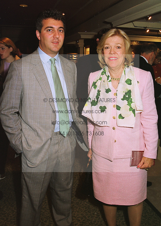 MR ADRIAN SASSOON and MRS KERRY PACKER wife of the Australian media tycoon, at a reception in London on 10th June 1998.MIE 9
