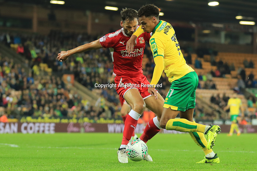 August 8th 2017, Carrow Road, Norwich, England; Carabao Cup First Round; Norwich City versus Swindon Town; Josh Murphy of Norwich City takes on Ben Purkiss of Swindon Town