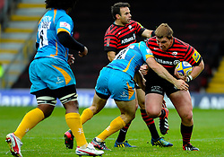 Saracens replacement (#16) John Smit is tackled by Wasps Inside Centre (#12) Chris Bell during the second half of the match - Photo mandatory by-line: Rogan Thomson/JMP - Tel: Mobile: 07966 386802 04/11/2012 - SPORT - RUGBY - Vicarage Road - Watford. Saracens v London Wasps - Aviva Premiership