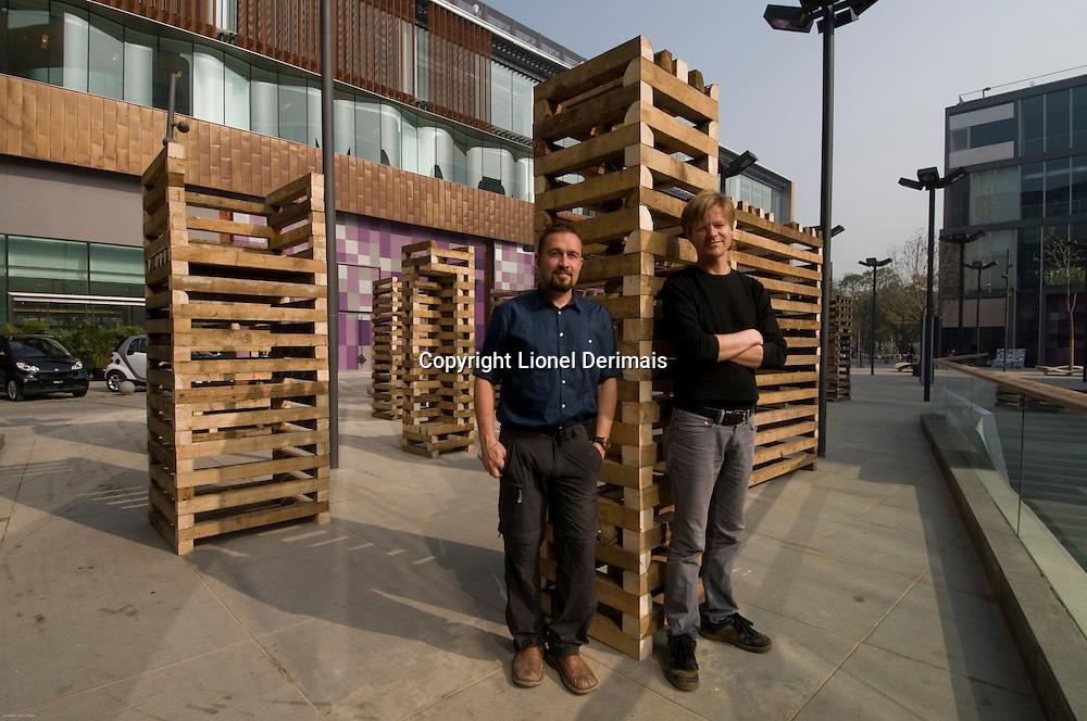 Sami Rintala(L) and Dagur Eggertsson(R) with their installation in Sanlitun North Village, Beijing. October 2009.